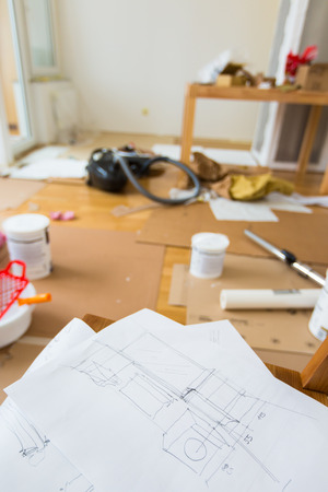 Sketch of home renovation in room full of painting tools photo