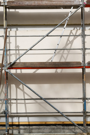 roofless: Metal scaffold for workers on partly assembled prefabricated house Stock Photo