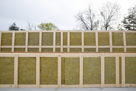 prefabricated: Insulated frames for prefabricated house with sky and trees