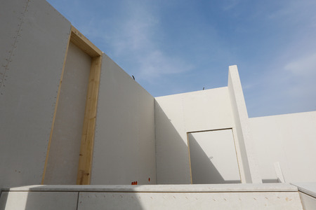 modular: Prefabricated roofless house in the making with blue sky