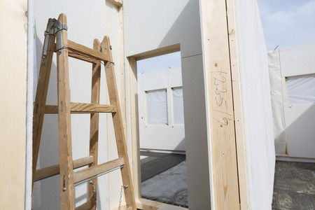 prefabricated: Placed walls of a prefabricated roofless house Stock Photo
