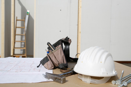 libel: Building equipment and building plan: helmet, hammer, workers tool bag, ladder, screws
