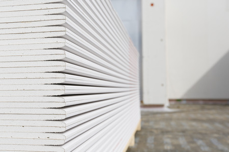 drywall: Stack of plasterboard panels at construction site