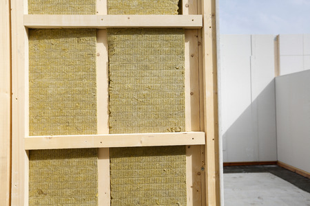 Insulated frame for prefabricated house at construction site Stock Photo