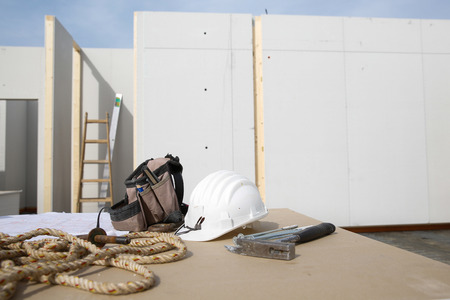 Building equipment, hardware and building plan: helmet, hammer, rope, worker photo
