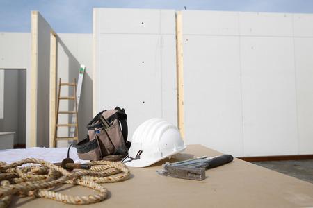 libel: Building equipment, hardware and building plan: helmet, hammer, rope, worker Stock Photo