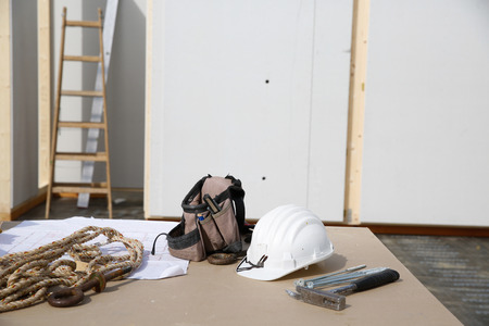 proffessional: Building equipment, hardware and building plan: helmet, hammer, rope, worker Stock Photo