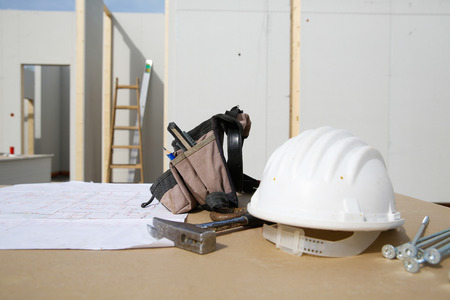 proffessional: Building equipment and building plan: helmet, hammer, worker