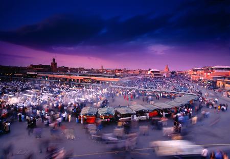 happening: Busy square Djemma el Fna, Marrakech, Morocco at dusk