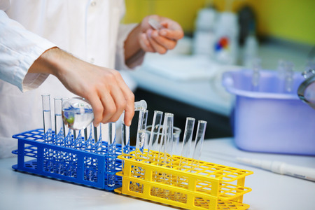 titration: Sample preparation in test tubes in laboratory Stock Photo