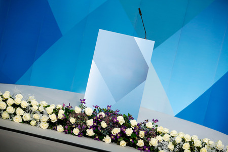 Rhetorical stage (podium) with microphone, appropriate for various occasions photo