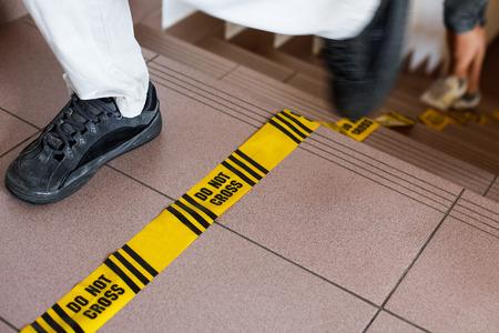 do not cross: Do not cross sign, forensic line, investigation in progress.