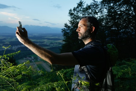 global positioning system: Hiker searching path to cache using global positioning device