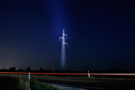 Pylon for electricity distribution at night with starry sky