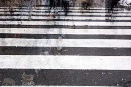 hurrying: People crossing a road, hurrying, blurred motion