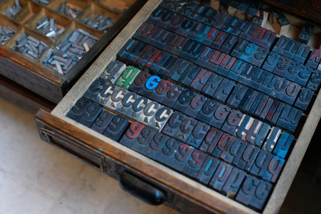 Old vintage wooden printing press letters in a drawer