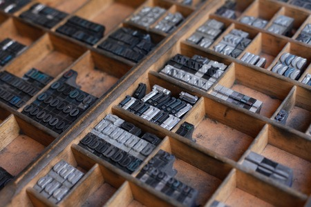 typesetter: Old vintage metal printing press letters in a drawer
