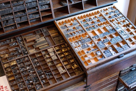 typesetting: An armour with printing press letters and accessories for typesetting