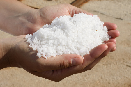 iodine: Woman holding a pile of freshly harvested salt Stock Photo