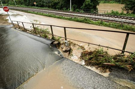 road closed: Flood aftermath, damaged road, hindered traffic
