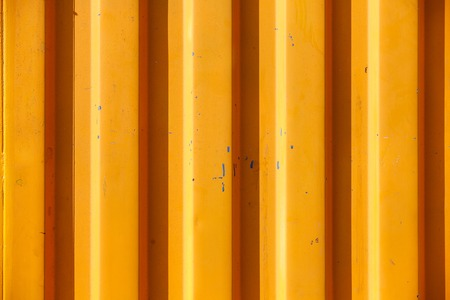 orange industry: Close-up of all-purpose textured and lined orange industrial background of a wall of actual mobile home container for industrial workers. Industrial, technological, blue-collar concept.
