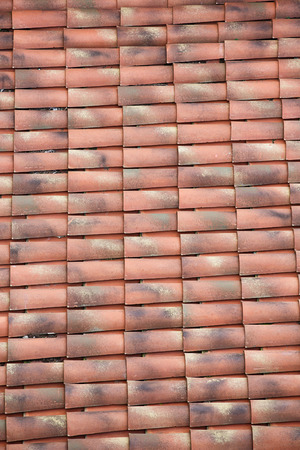 mediterranean house: View of unique, weathered terracotta roof of a Mediterranean house. Textured effect background. Construction, home, protection and travel concept. Stock Photo