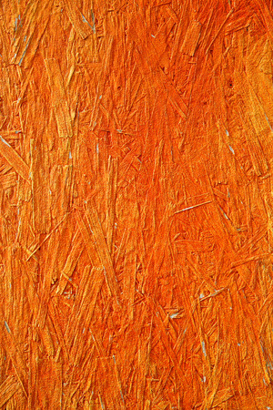 symbolism: Orange colored, unique and uniform textured abstract background.  Caution, danger, Buddhism, Hinduism symbolism and concept.
