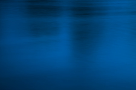 uneasiness: Deep and blurred, dark blue and black water surface, conceptual abstract background. Dark, sullen atmosphere, uneasiness, crime, fear, underground, and evil concept.