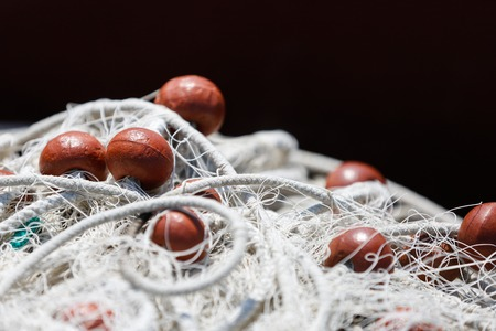 overfishing: Fishing net with red floats on the float line, fisheries concept background, with space for your text. Stock Photo