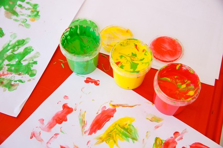experiential: Finger paints in bright colors, used for finger drawing and sensory play. Innovative approach to learning and back to school concept.