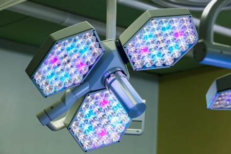 medical light: LED surgical lights system in operating room, illuminating the operating table for the surgeon. Healthcare, surgery, medical technology concept. Stock Photo