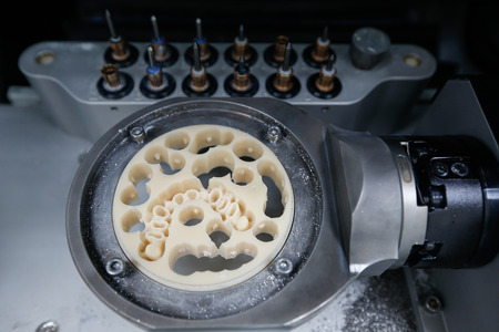 CADCAM dental machinery in a highly modern dental laboratory, with disc for prosthesis and crowns milling. Stock Photo