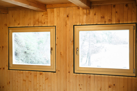 wasteful: New efficient, three pane wooden windows installed in an old wooden house, replacing wasteful old windows.