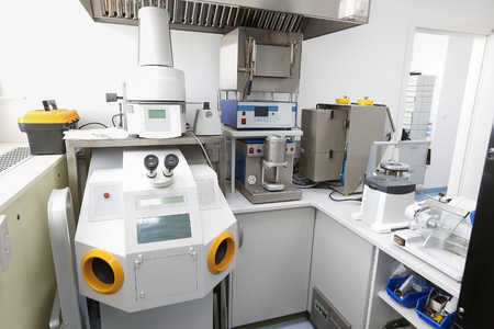 Computer controlled dental microscope in a hi-tech, modern laboratory.