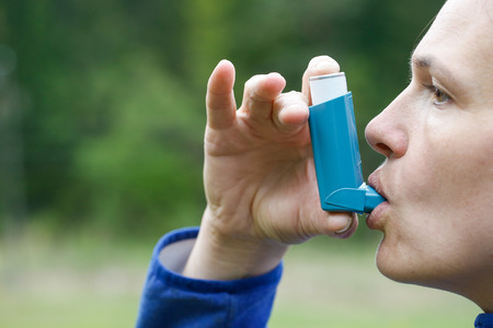 disease control: Asthma patient inhaling medication for treating shortness of breath and wheezing. Chronic disease control, allergy induced asthma remedy and chronic pulmonary disease concept.