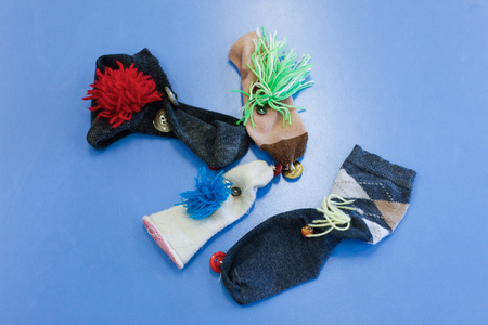 sock puppet: Do-it-yourself hand and finger puppets, made of socks. Learning through experience concept, creative playing and educational approach concept. Stock Photo