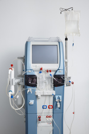 purification: Hemodialysis machine with tubing and installations. Health care, blood purification, kidney failure, transplantation, medical equipment concept. Stock Photo