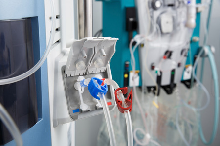 Hemodialysis bloodline tubes connected to hemodialysis machine. Health care, blood purification, kidney failure, transplantation, medical equipment concept. Stock Photo - 62101028