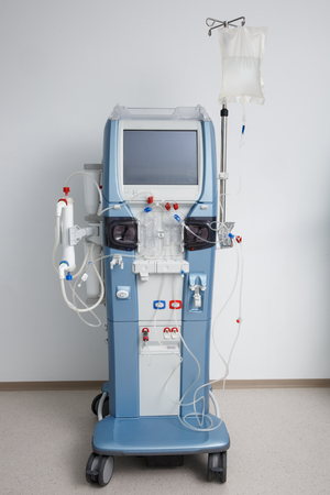 Hemodialysis machine with tubing and installations. Health care, blood purification, kidney failure, transplantation, medical equipment concept with copy space.