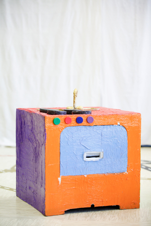Do-it-yourself kitchen stove, made from recycled material. Imaginative and creative playing and creation, educational approach concept.