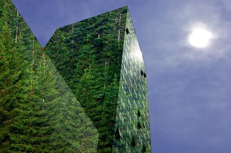 Verde, las energías renovables en la ciudad: moderno edificio cubierto de bosque de abetos. Concepto de energía sostenible, contaminación y urbanidad con espacio de copia.