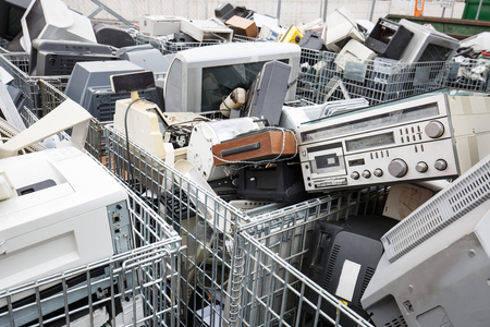 Electronic devices dump site. E-waste disposal, management, reuse, recycle and recovery concept. Electronic consumerism, globalization, raw material source concept.