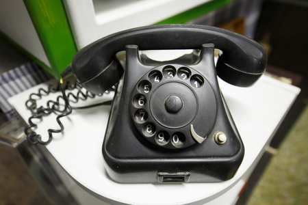 Old vintage telephone with rotary dial numbers. Vintage items, back to basics, retro love concept.