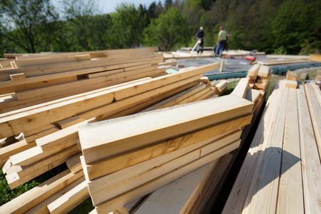 Pile of numbered, cut and prepared wood planks, 2x4