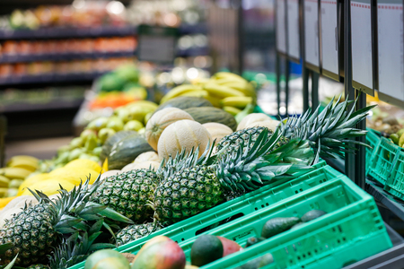 Unpacked, fresh exotic fruits in a self-service supermarket. Zero-waste movement and philosophy, sustainable trade and organic grocery concept.