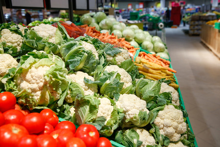 Unpacked, fresh vegetables in a self-service supermarket. Zero-waste movement and philosophy, sustainable trade and organic grocery concept.