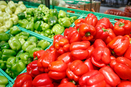 Unpacked, fresh and colourful peppers in a self-service supermarket. Zero-waste movement and philosophy, sustainable trade and organic grocery concept. Imagens