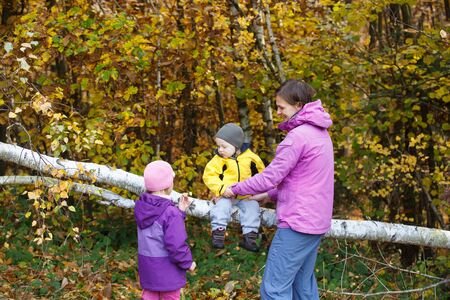 Mother with children together in nature on a nice autumn day. Family concept. Banco de Imagens - 129949825