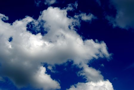 White fluffy clouds against the blue sky Stock Photo