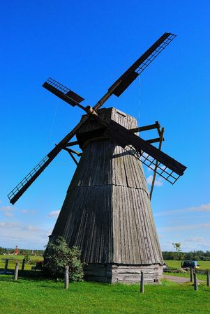 Old wooden windmill against the sky photo